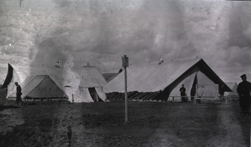 <p>Personnel standing outside tents at the Division Field Hospital.</p>
