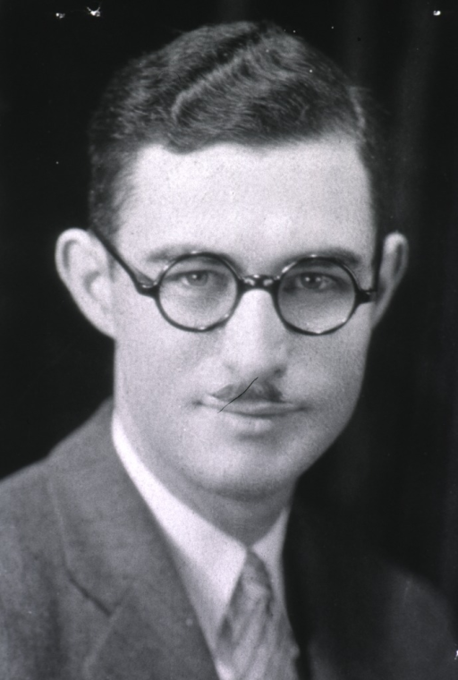 <p>Head and shoulders, full face, glasses, mustache.</p>