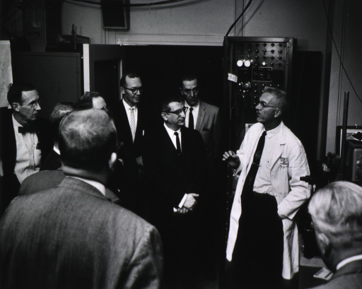 <p>Roy Perry, NIH Photographer, and Dr. George Williams, Chief of Clinical Pathology Dept., conduct session for Washington Chapter of Society of Photographic Engineers and Scientists under the auspices of the Photographic Section.</p>