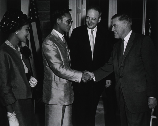 <p>Dr. Roderick Murray, Director of the Division of Biologics Standards, greets the King and Queen of Thailand, as DHEW Secretary Arthur Flemming looks on.</p>