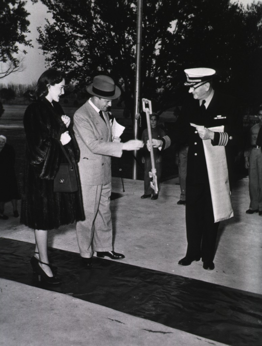 <p>A PHS officer hands a large skeleton key to Bergen during a red carpet ceremony.</p>
