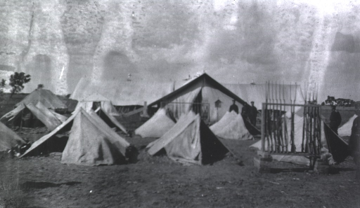 <p>Soldiers standing near their tents at the Division Field Hospital.</p>