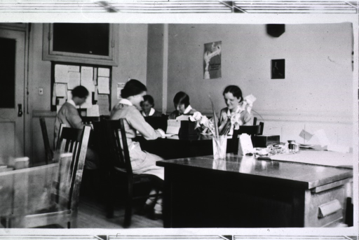 <p>View of staff members working in the office at their desks.</p>