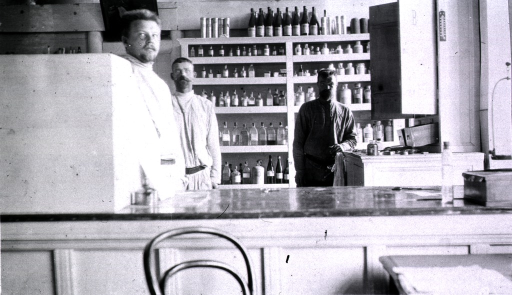 <p>Three medical personnel stand in the dispensary at Military Hospital No. 3.</p>