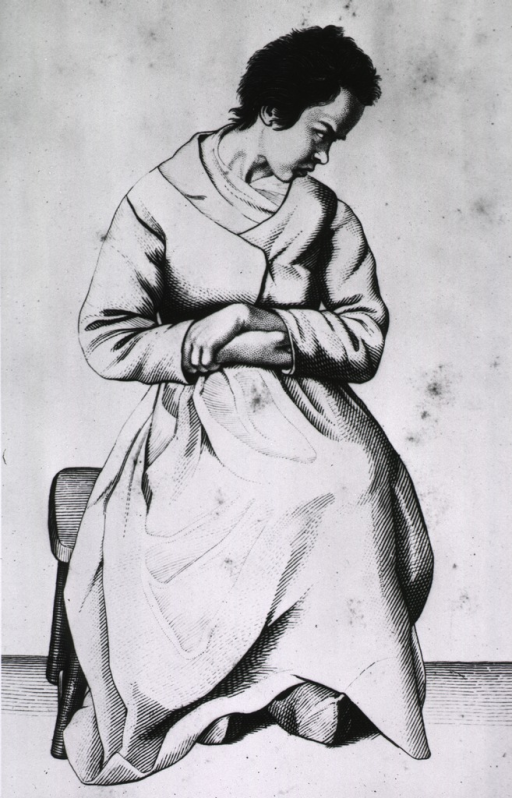 <p>A woman is sitting on a stool, hands together in front, and head turned to right profile.</p>