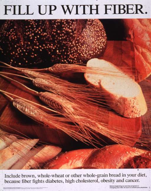 <p>White poster with black lettering.  Title at top of poster.  Poster dominated by reproduction of a color photo of bread and a few strands of wheat.  Caption and note below photo.</p>