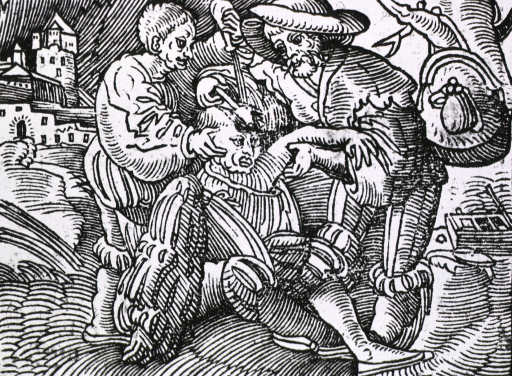 <p>Man seated in field, being treated for head wound by two others.</p>