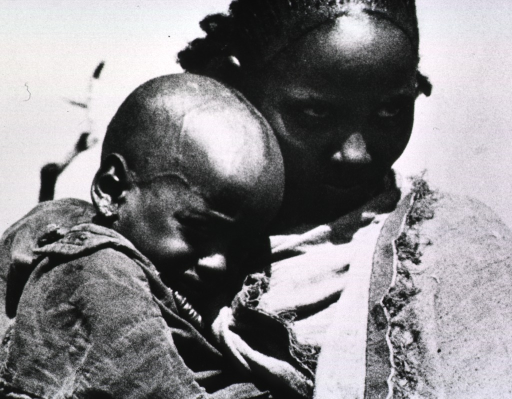 <p>A mother holding her child who was suffering from pneumonia.</p>