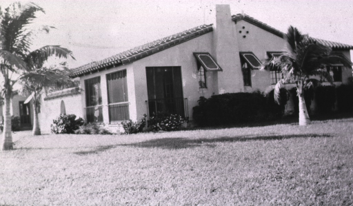 <p>Exterior view: Spanish style building with palm trees.</p>
