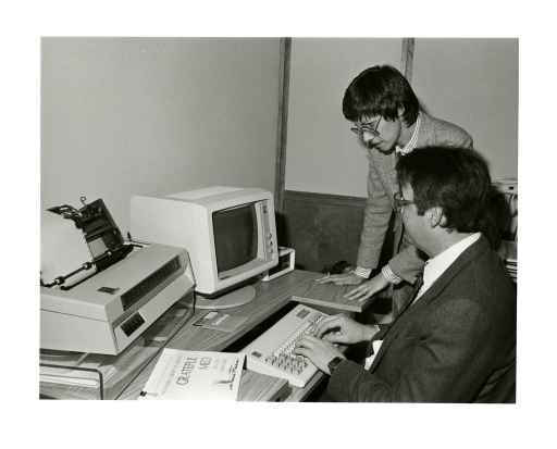 <p>Office of Computer and Communications Systems (OCCS) Director John Anderson works with Reference Librarian Rosemary Woodsmall on an early installment of Grateful Med.</p>
