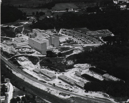 <p>Exterior view: aerial view with the teaching hospital and clinics on the left; the medical sciences building on the right.</p>