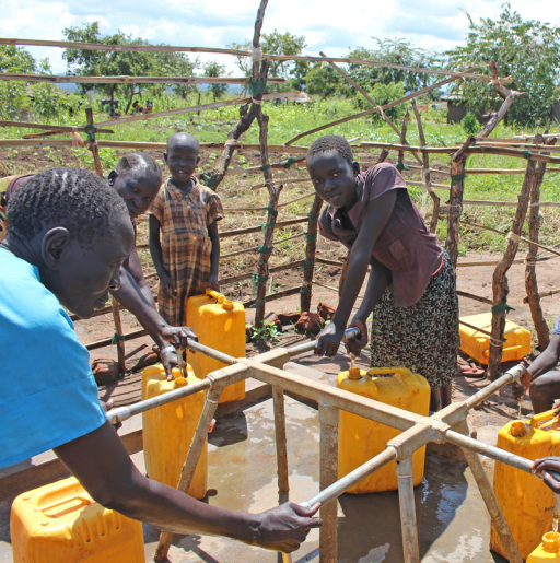 Refugees collect water from a public tap stand in an Adjumani settlement.© Wendee Nicole