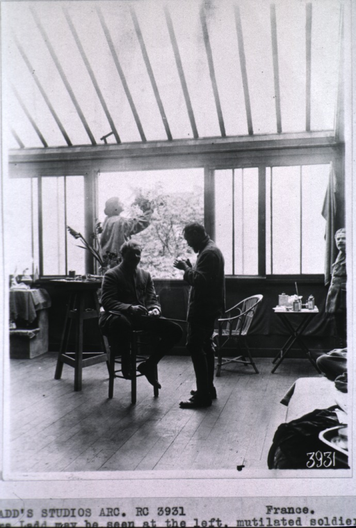 <p>Interior view of Mrs. Ladd's studio; showing two unidentified people.</p>
