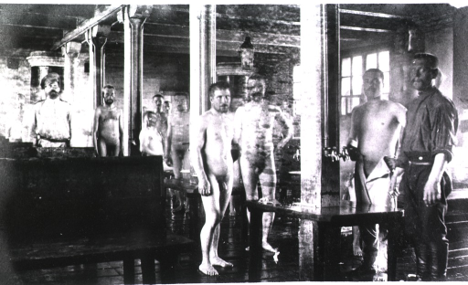 <p>An interior scene of soldiers in their bath house.</p>