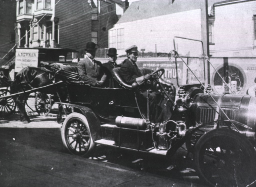 <p>Portrait of Dr. Rupert Blue (left) and Dr. William C. Rucker (right), Passed Assistant Surgeons with the United States Public Health and Marine Hospital Service, seated in the back seat of a chauffered automobile on a San Francisco street during the plague campaign.</p>