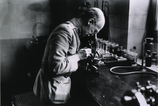 <p>Seated in laboratory.</p>