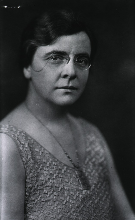 <p>Head and shoulders, right pose, full face, wearing glasses.</p>