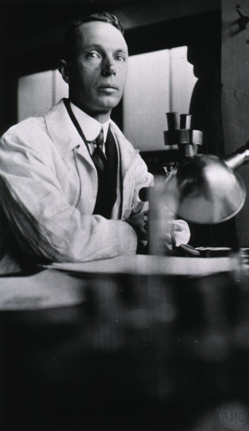 <p>Standing at table in laboratory.</p>