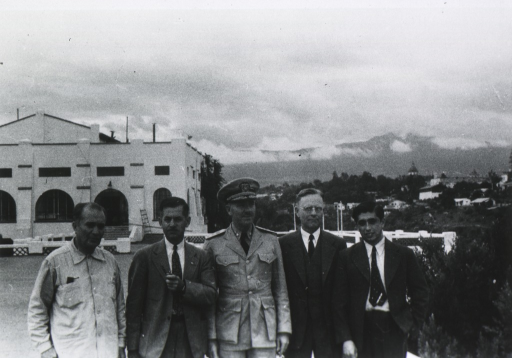 <p>Standing in group, all half-length, full face; others unidentified.</p>
