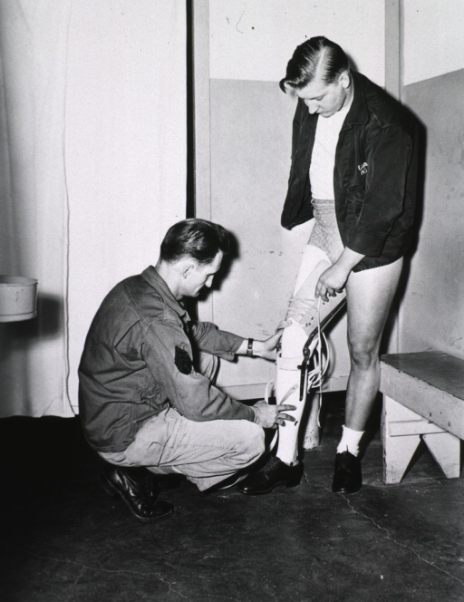 <p>A young man having his right amputated leg fitted with a prosthetic leg.</p>