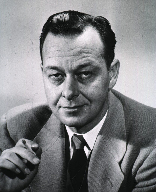 <p>Head and shoulders, left pose, full face; holding cigarette in right hand.</p>