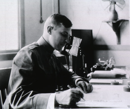 <p>Half-length, right profile, seated at desk, writing; wearing uniform.</p>