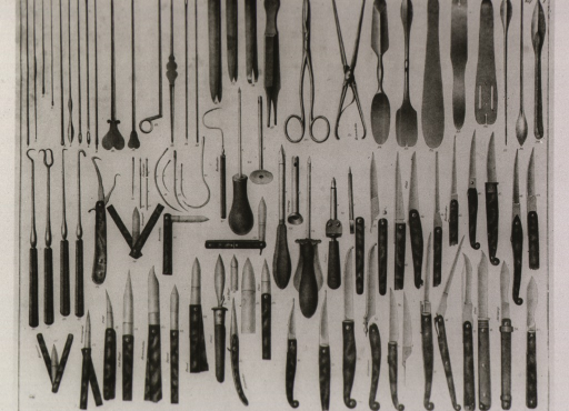 <p>Needles, tweezers, hooks, picks, razors, and other instruments are arranged by type; some identified as the particular type used by noted surgeons.</p>