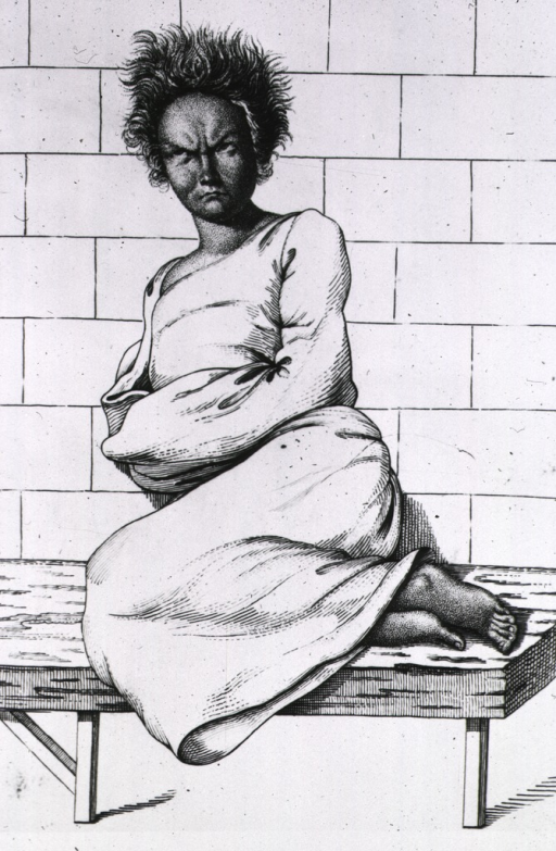 <p>A woman is sitting on her side with her feet drawn up on a bench, she is supported by a wall behind the bench; she appears to be wearing a gown that inhibits movement of her arms.</p>