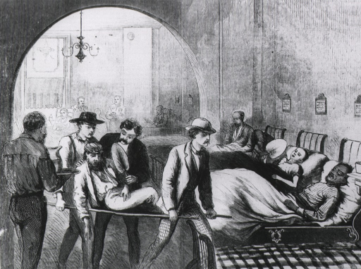 <p>Patient on stretcher in foreground of ward.</p>