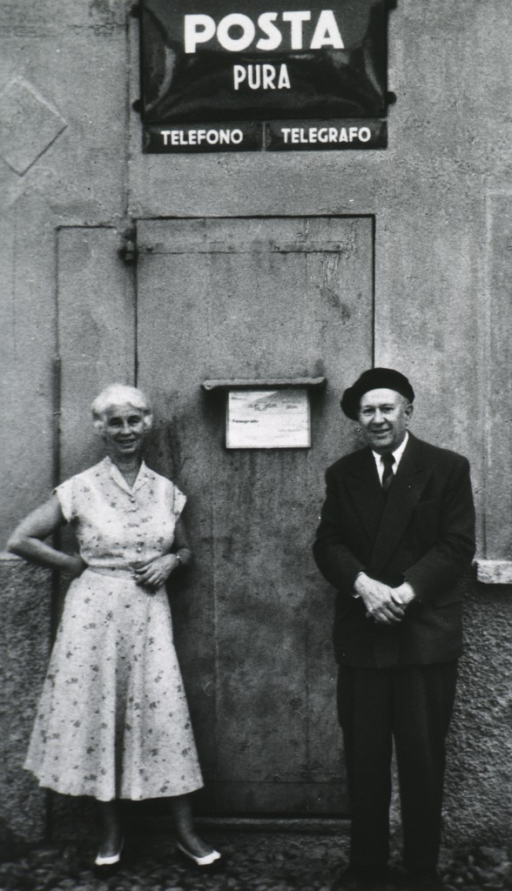 <p>Full length, standing in front of building, with his wife &quot;Emmy&quot;.</p>