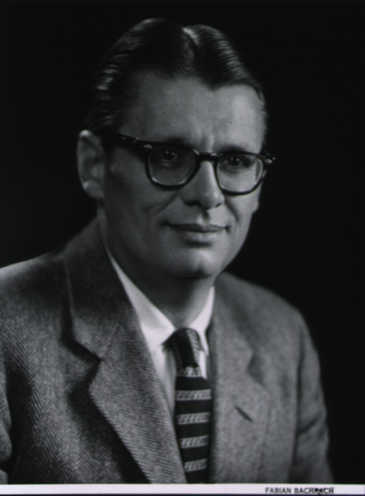 <p>Head and shoulders, turned slightly to right; wearing glasses.</p>