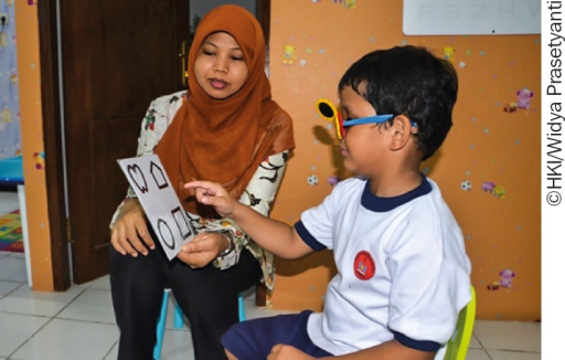 Henny Nurjanah uses Lea symbols to assess a child's vision