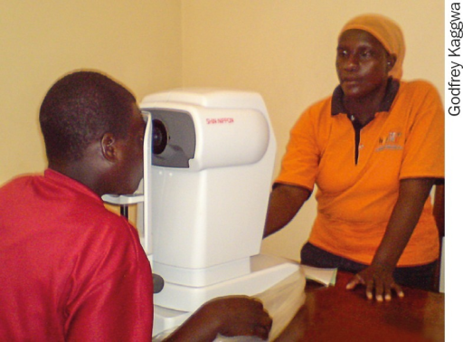 An OCO refractionist (right) with a patient