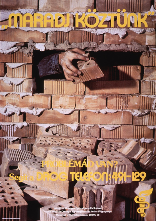 <p>Multicolor poster with yellow and white lettering.  Title at top of poster.  Visual image is a color photo reproduction of a hand reaching out from a small gap in a brick wall.  The hand holds a brick.  Caption superimposed on photo near bottom of poster inquires about having a problem and urges seeking help from drug abuse hotline.  Publisher information at bottom of poster.</p>