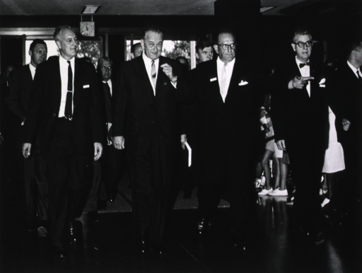 <p>President Johnson, Surgeon General William Stewart, Jack Masur, and Dr. James A. Shannon entering the Clinical Center.</p>