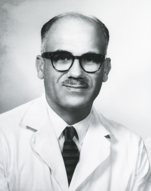 <p>Head and shoulders, full face, wearing glasses and lab coat.</p>