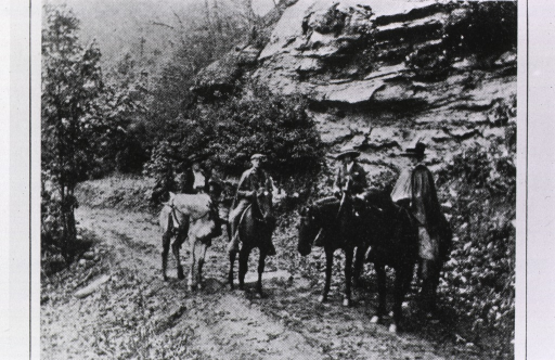 <p>Four travelers on horseback.</p>