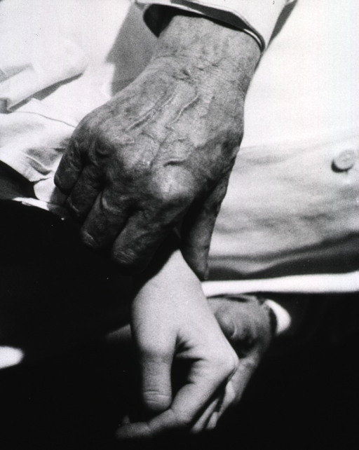 <p>The hands of Professor Clarence Crafoord of Stockholm, a pioneer of modern heart surgery, are shown taking the pulse of a patient (of whom only a hand is shown).</p>