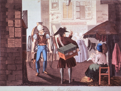 <p>Street scene: Amidst a clutter of buildings, a man tows a two wheeled cart, another man carries a box on his back, and a woman has set up an open-air garment shop. A dentist's sign hangs over a door in the background.</p>
