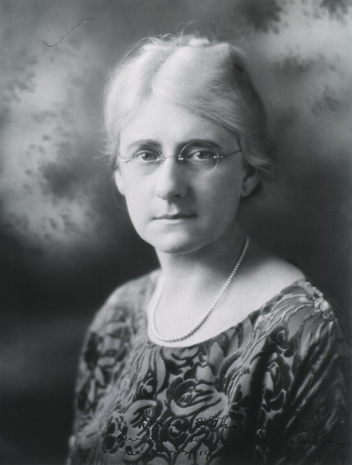 <p>Head and shoulders, left pose; face front.  Wearing glasses, white hair.</p>