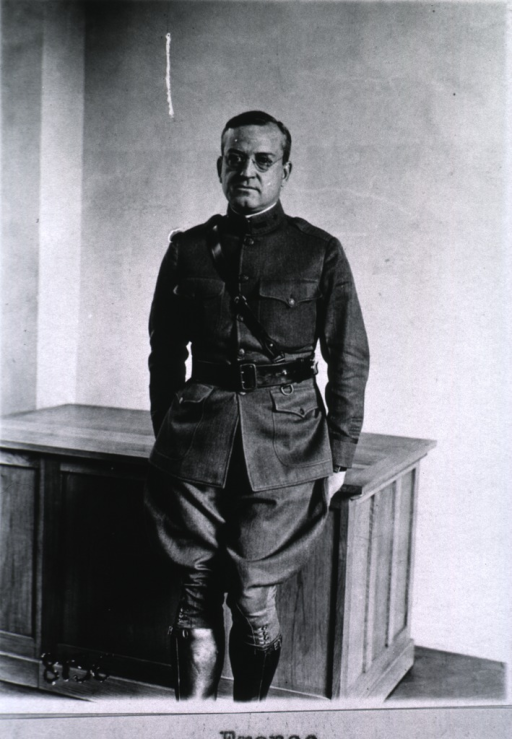 <p>Three-quarter length, leaning against desk, full face; wearing uniform (Colonel).</p>