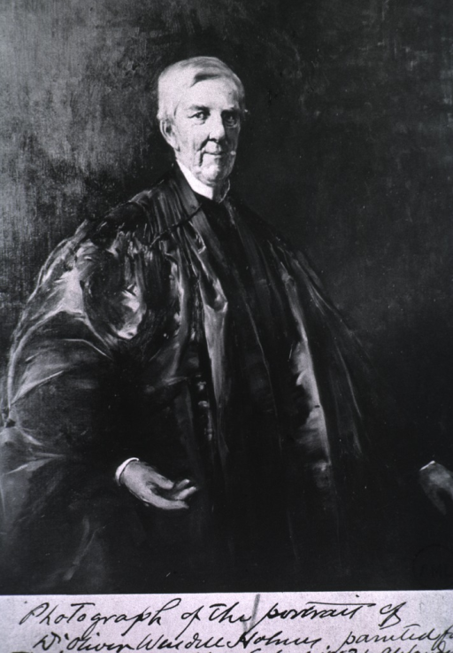 <p>Standing, wearing robes, full face.</p>