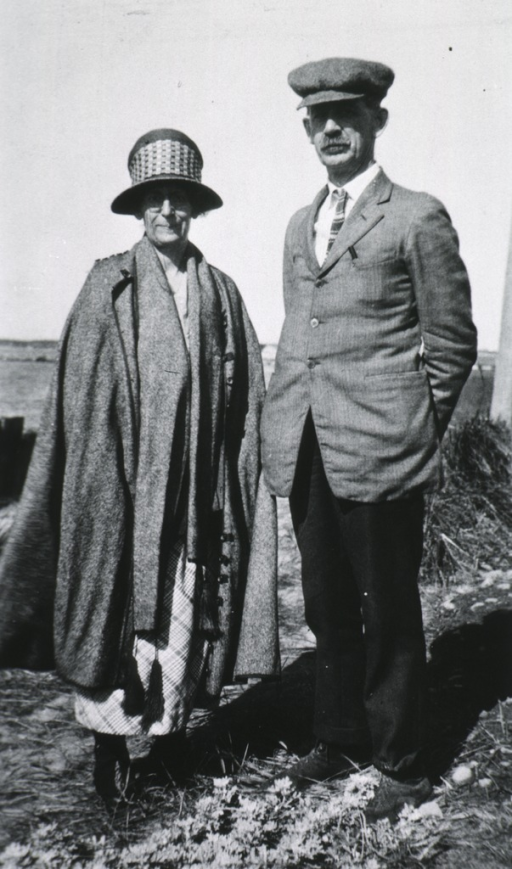<p>Both full length, standing out-of-doors, wearing coats and hats.</p>