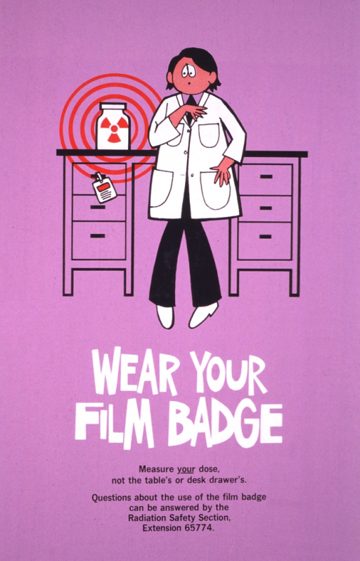 <p>The upper half of the poster shows the figure of a man in a lab coat with a worried look on his face, searching the front of his coat for his film badge.  His desk is behind him, and there is a container with radioactive material in it and his film badge is hanging on the handle of his desk drawer.</p>