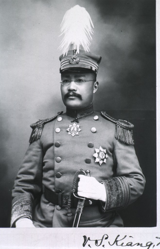 <p>Half-length, seated, full face; wearing uniform and cap; holding sword.</p>