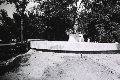 <p>Exterior view showing large concrete platform with a pump in the center.</p>
