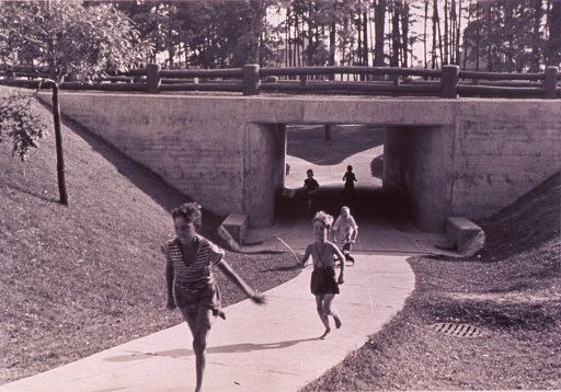 <p>Children playing at underpass at Greenbelt, Maryland.</p>