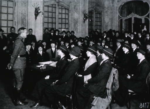 <p>Full length, right profile; hands behind back; wearing uniform; addressing group of Red Cross nurses that had just arrived in France.</p>