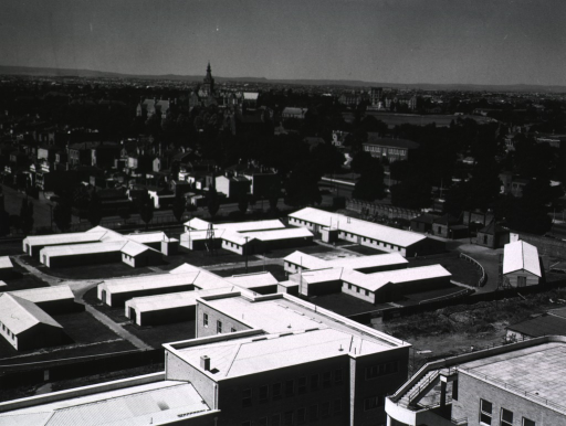 <p>An aerial view of the hospital compound in the foreground, with the cityscape rising in the background.</p>