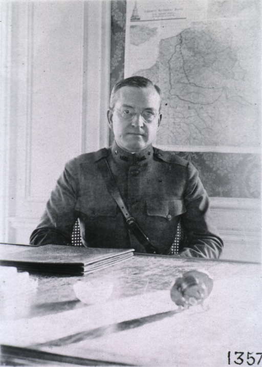 <p>Head and shoulders, full face; seated at desk; wearing uniform.</p>